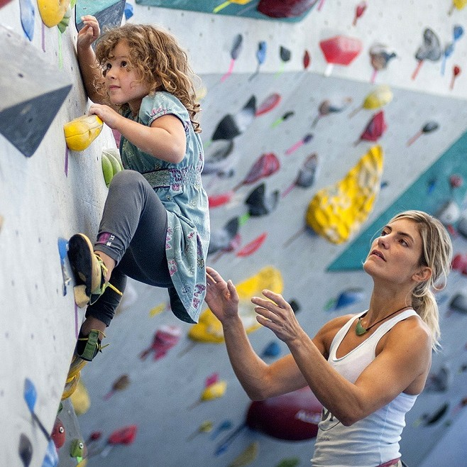 MONTREAL, QUE.: AUGUST 16, 2013-- Catherine Brunel-Guitton spots her daughter Sasha Duchêne, 4, at Allez-Up climbing centre in Montreal on Friday, August 16, 2013. Brunel-Guitton is among a group of families with children ranging from five-days-old to five-years-old who climb together at the Montreal based gym. (Justin Tang / THE GAZETTE)
