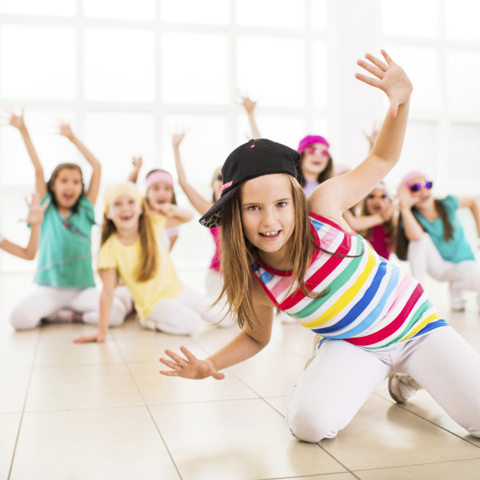 Group of little girls dancing. Focus is on foreground, on a little girl in a dance move looking at the camera.   [url=http://www.istockphoto.com/search/lightbox/9786682][img]http://dl.dropbox.com/u/40117171/children5.jpg[/img][/url]  [url=http://www.istockphoto.com/search/lightbox/9786738][img]http://dl.dropbox.com/u/40117171/group.jpg[/img][/url]